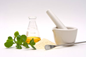 flask,leaves,powder,mixer, mortar and pestle